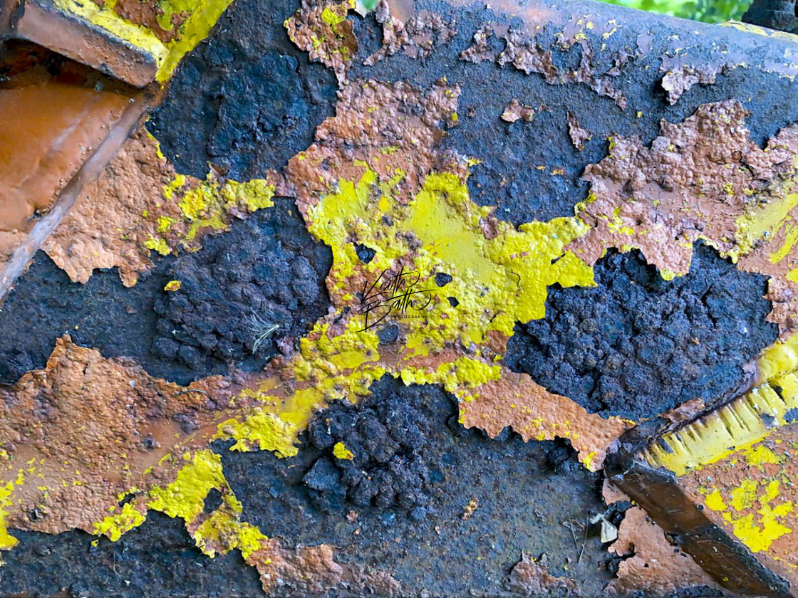 """Flaking paint on farm machinery"" stock image"