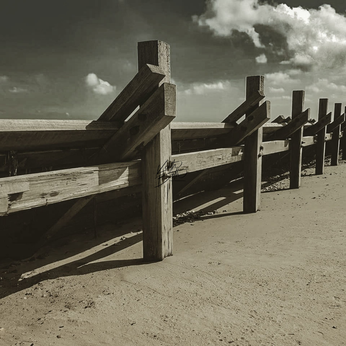 """Wooden structure along the beach at Bacton, Norfolk"" stock image"
