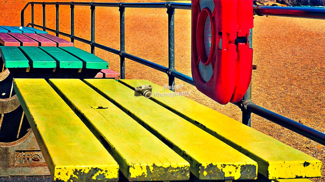 """""""Colourful Beach Benches and Metal Hand Rail"""" stock image"""