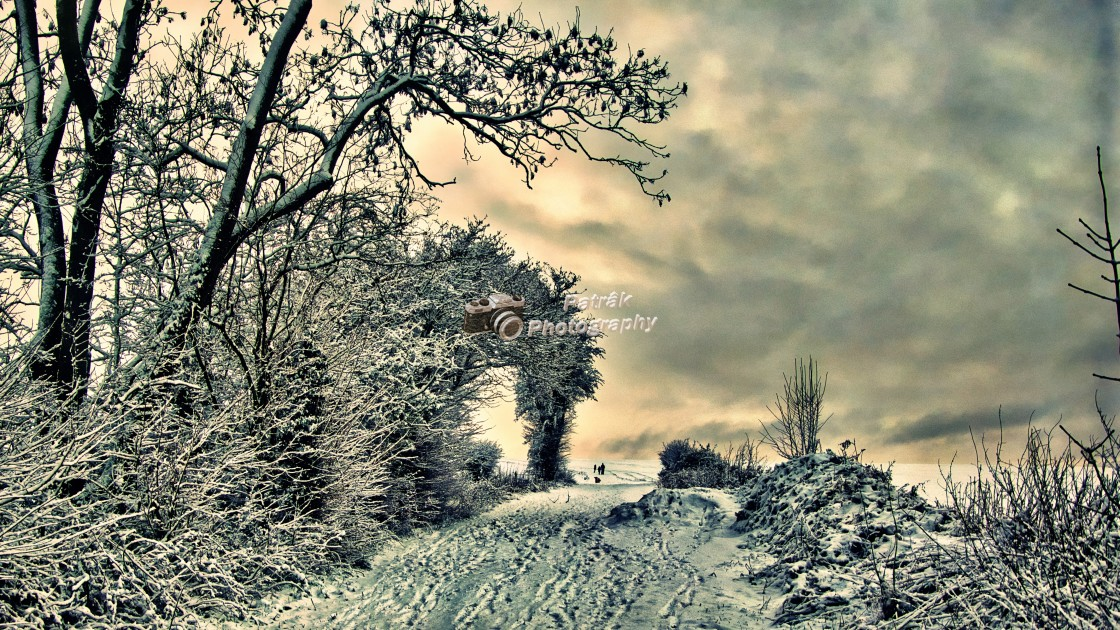 """""""Walkers In The Snow - Nine Hills, Devizes, Wiltshire, England"""" stock image"""