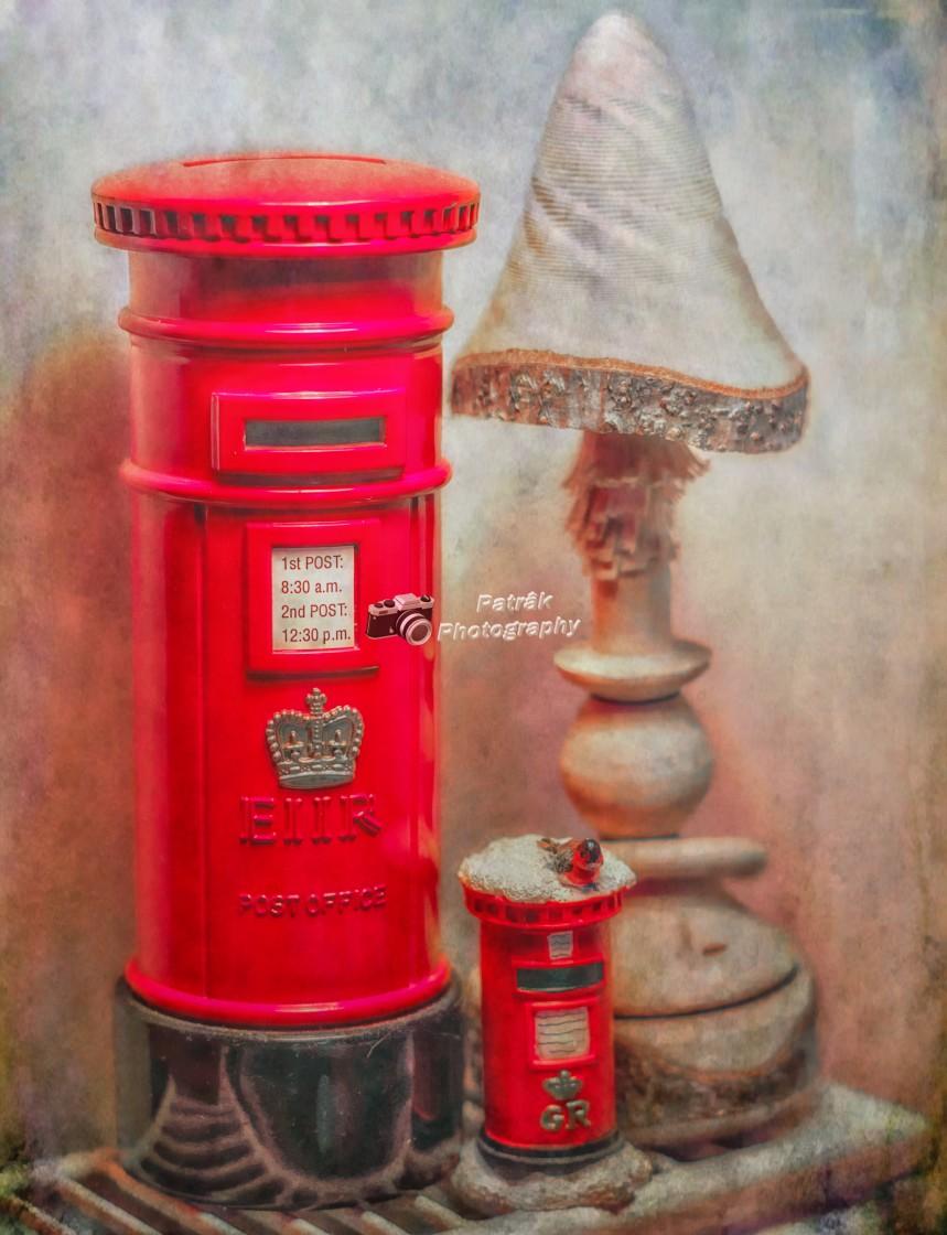 """Post Box's & Wooden Toadstool Still Life"" stock image"