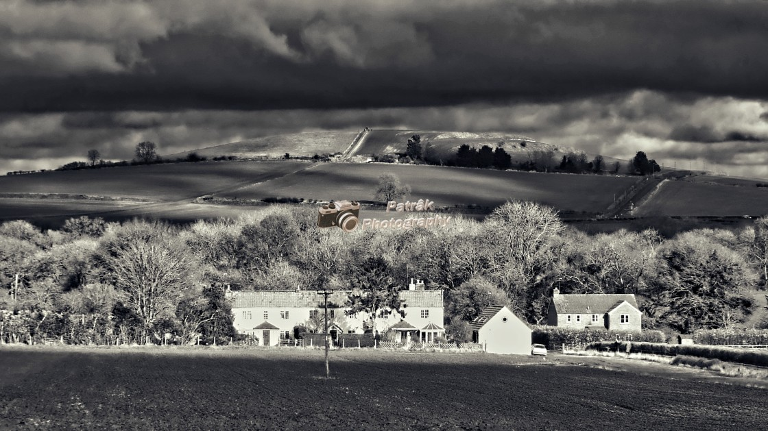 """""""Storm Clouds & Sunlight Over Etchilhampton Hill"""" stock image"""