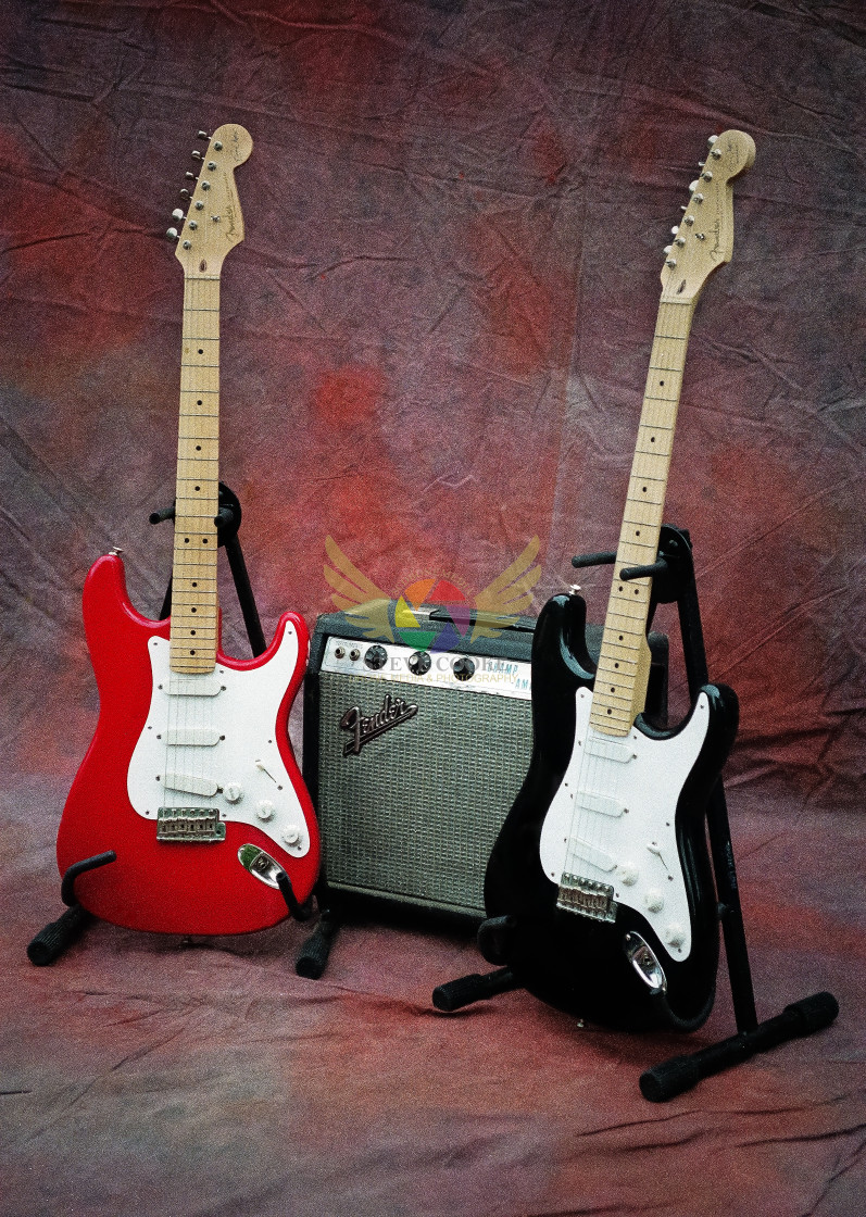 """""""Red & Black Fender Stratocaster Guitars with Fender Champ Amplifier - Owned by Bernie Marsden"""" stock image"""