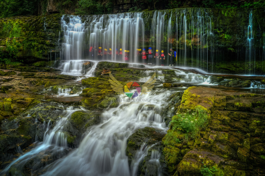 """""""'Canyoners' Under Sgwd Isaf Clun Gwyn, Afon Mellte (Mellte River), Brecon Beacons, Wales"""" stock image"""