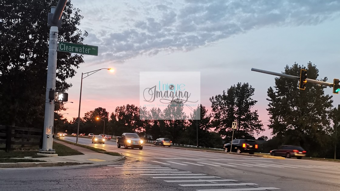 """""""A sunset at rushhour"""" stock image"""