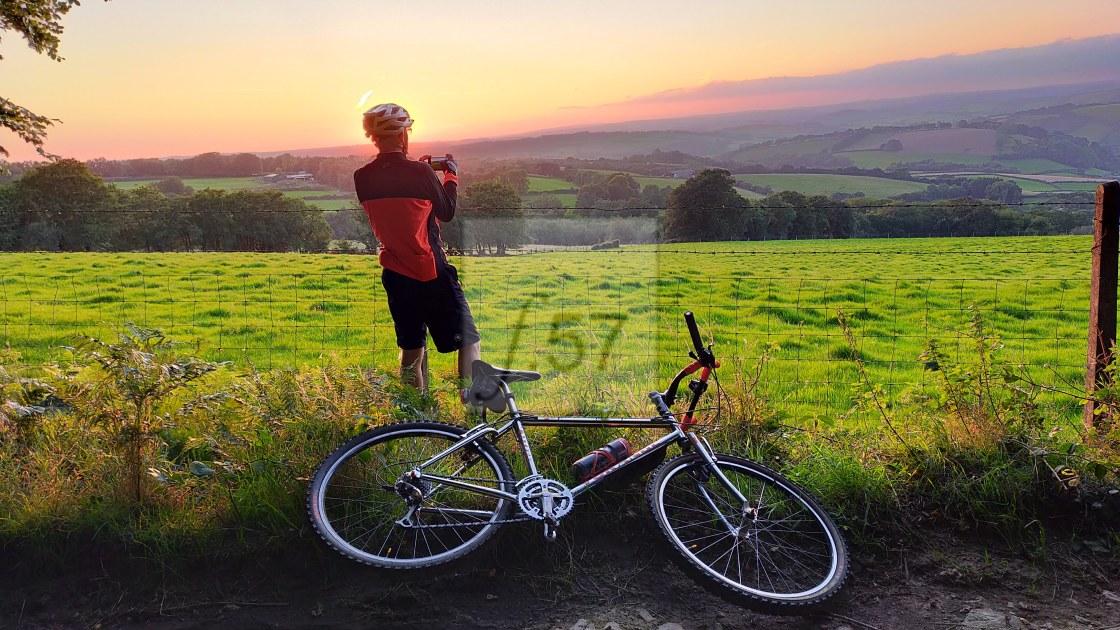 """""""Evening cycle sunset photo"""" stock image"""