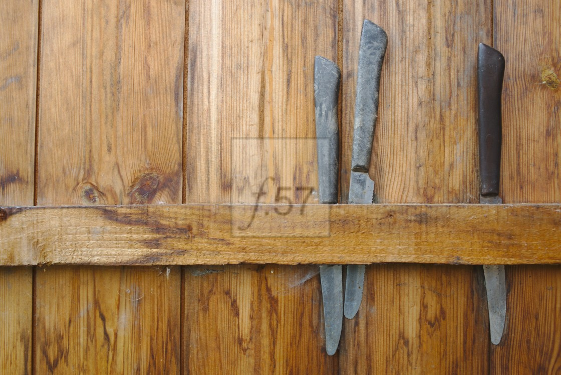 """""""knives stored behind shed door at an allotment"""" stock image"""