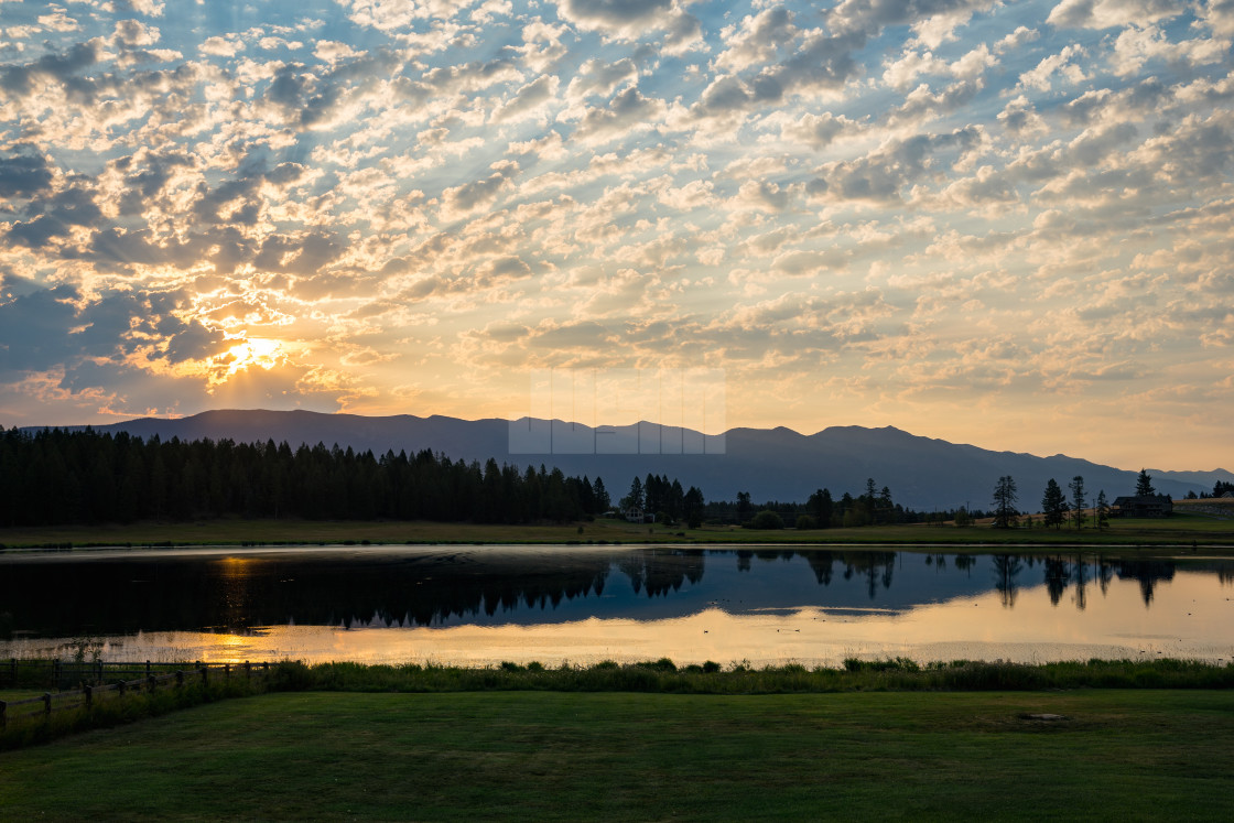 """Sunset Over a Lake in Whitefish Montana"" stock image"