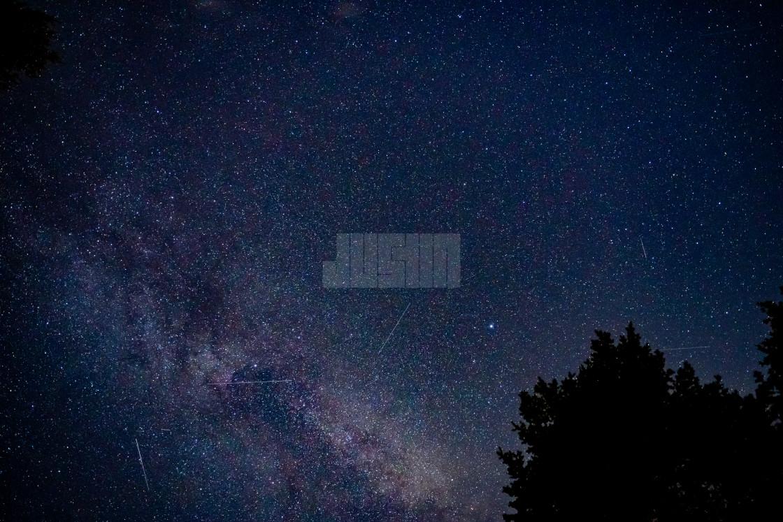 """Milky Way in the Night Sky over Glacier National Park in Montana"" stock image"