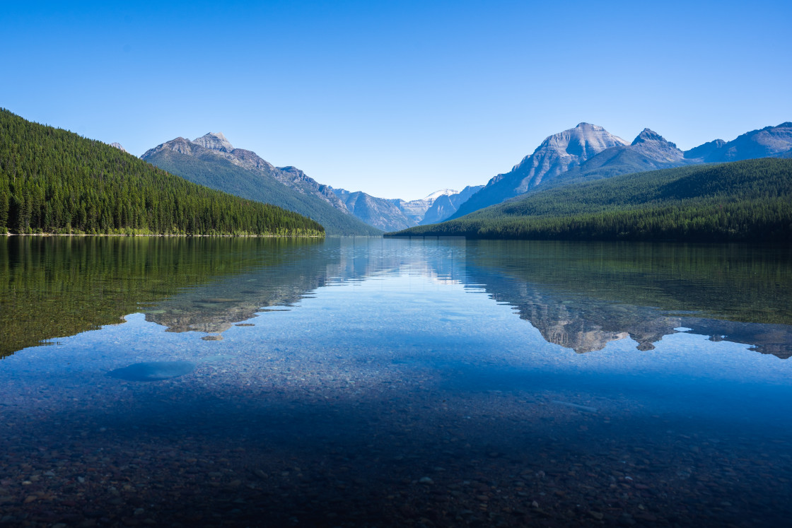 """Calm Lake Bowman with a Reflection of Mountains in the Backgroun"" stock image"