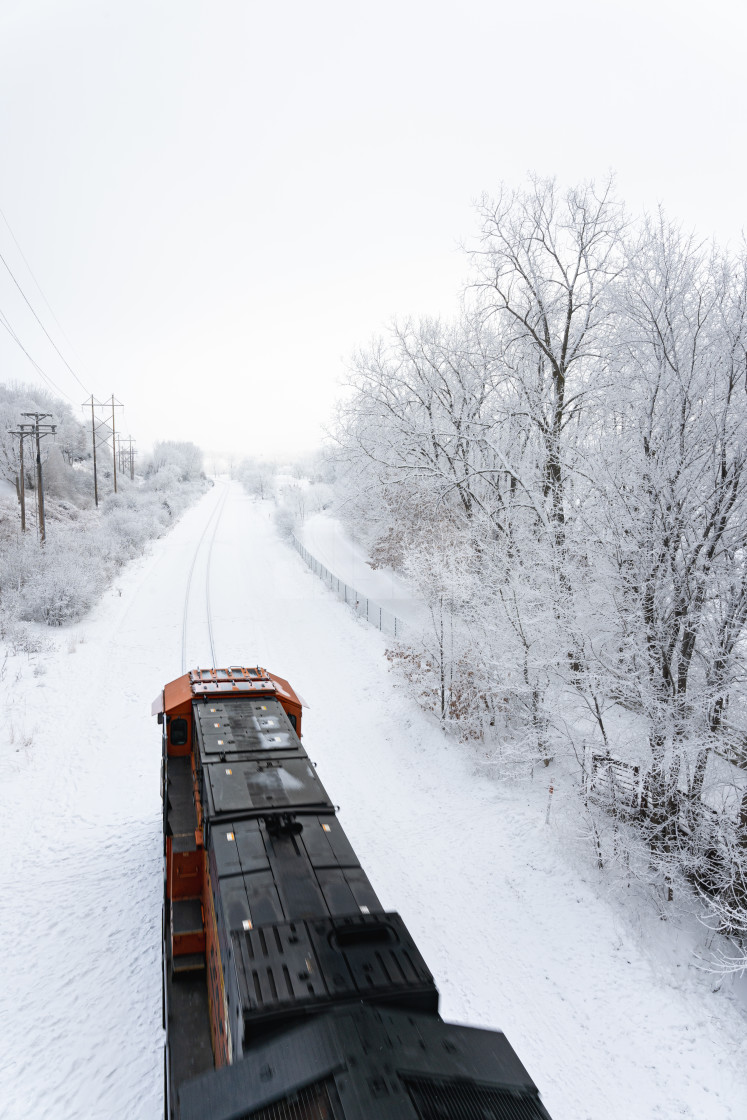 """train passing through fresh snow fall on the tracks"" stock image"