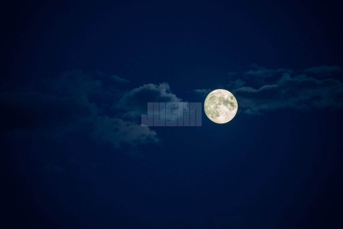 """full moon in the night sky with clouds"" stock image"