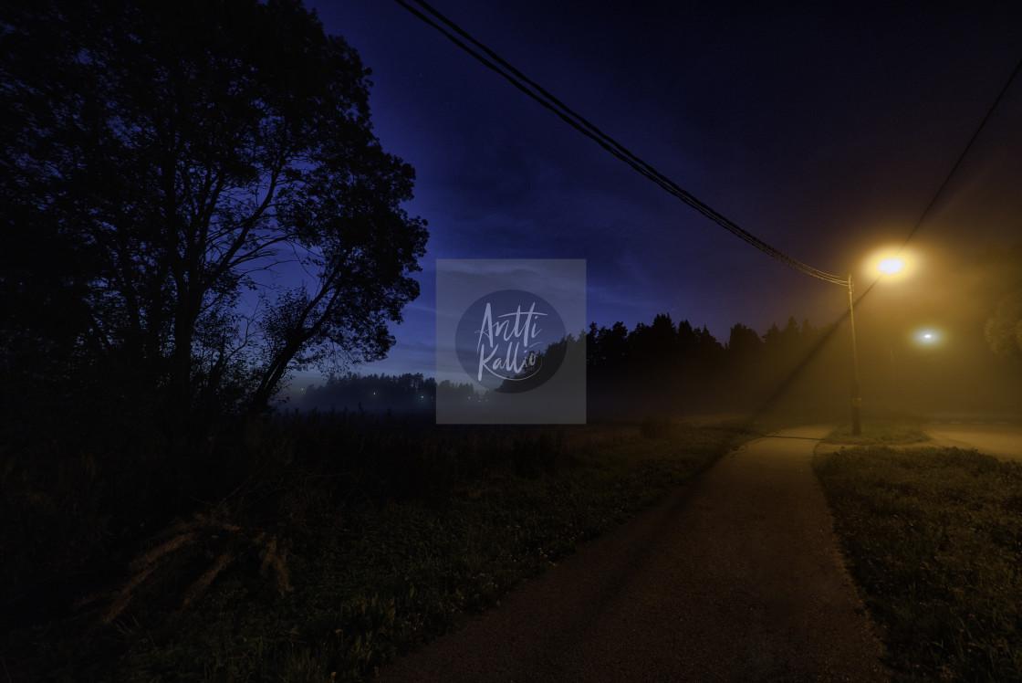 """Dramatic dark night walk way"" stock image"