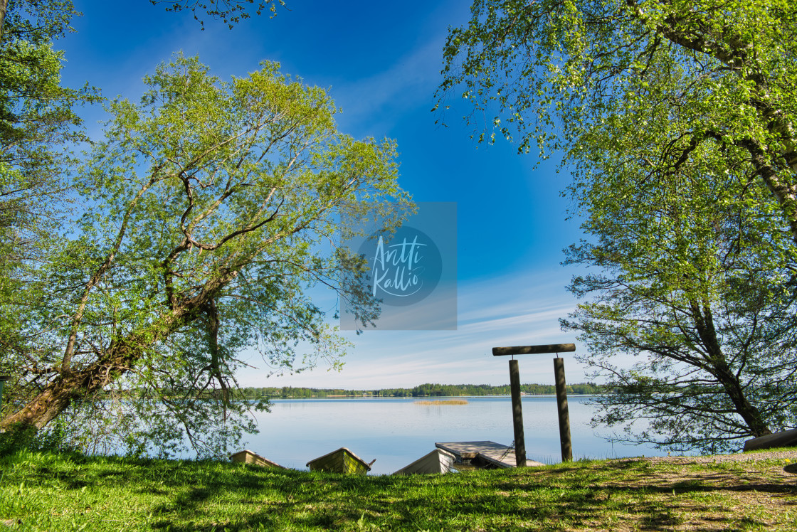 """""""Spring view at a Finnish lakeside"""" stock image"""