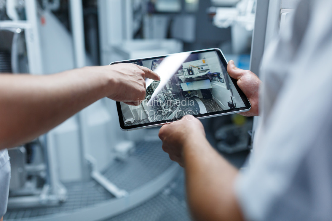 """Hand holding tablet industry 4.0"" stock image"