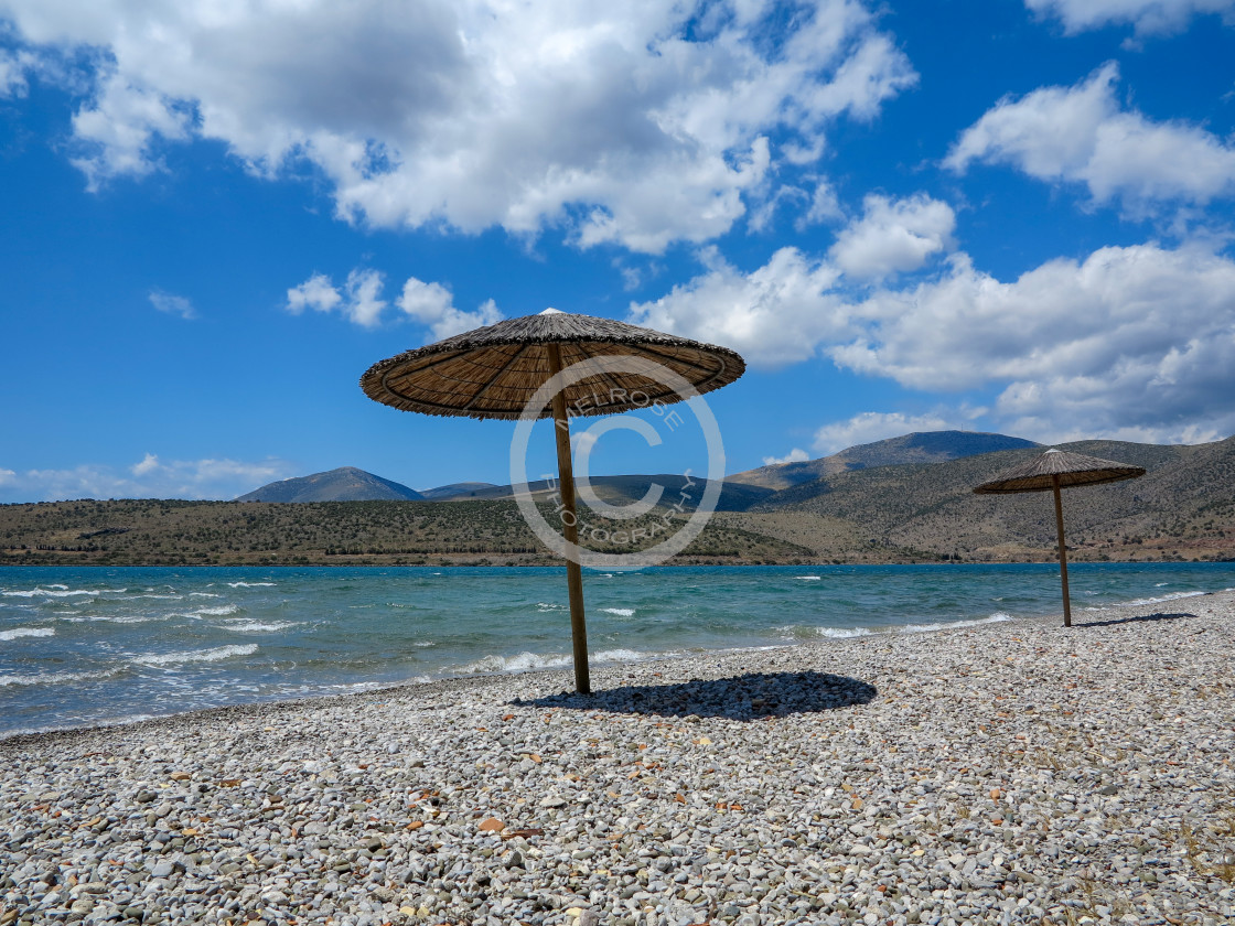 """Parasol shading the empty Beach"" stock image"