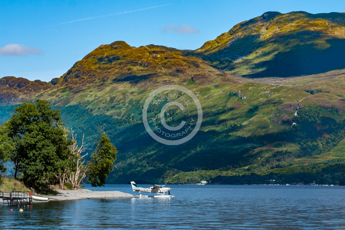 """""""Loch and Mountain view in Glencoe Scotland with private plane"""" stock image"""