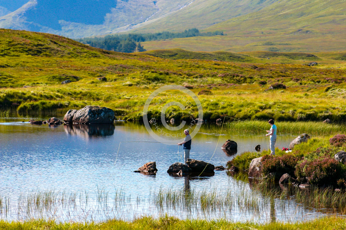 """""""A fishing Loch and Mountain view in Glencoe Scotland"""" stock image"""