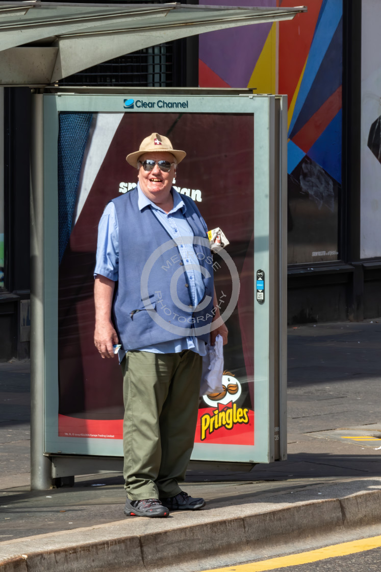 """Deputy Dawg happy guy waiting on the bus"" stock image"