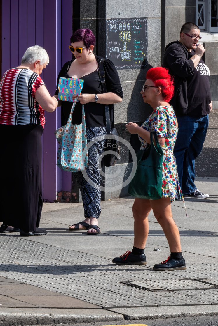 """""""Little Redhead standing out in the crowd"""" stock image"""