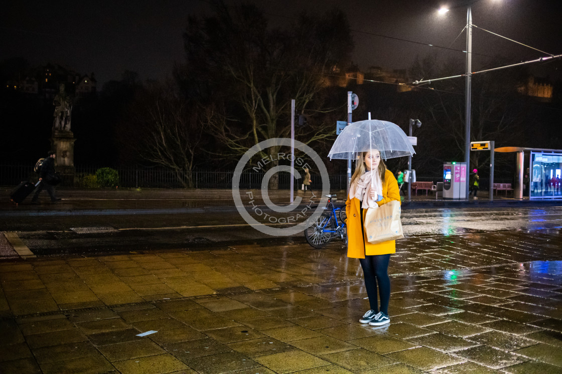 """""""Standing in the rain"""" stock image"""