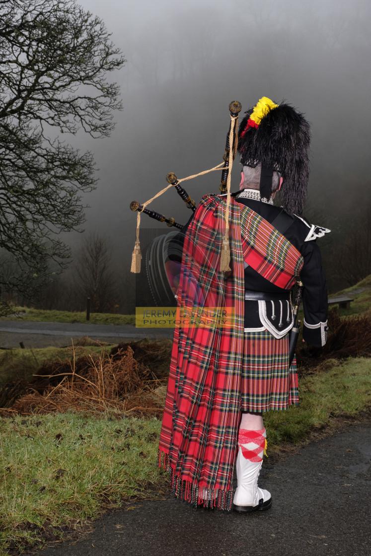 """The Scottish Bagpiper"" stock image"