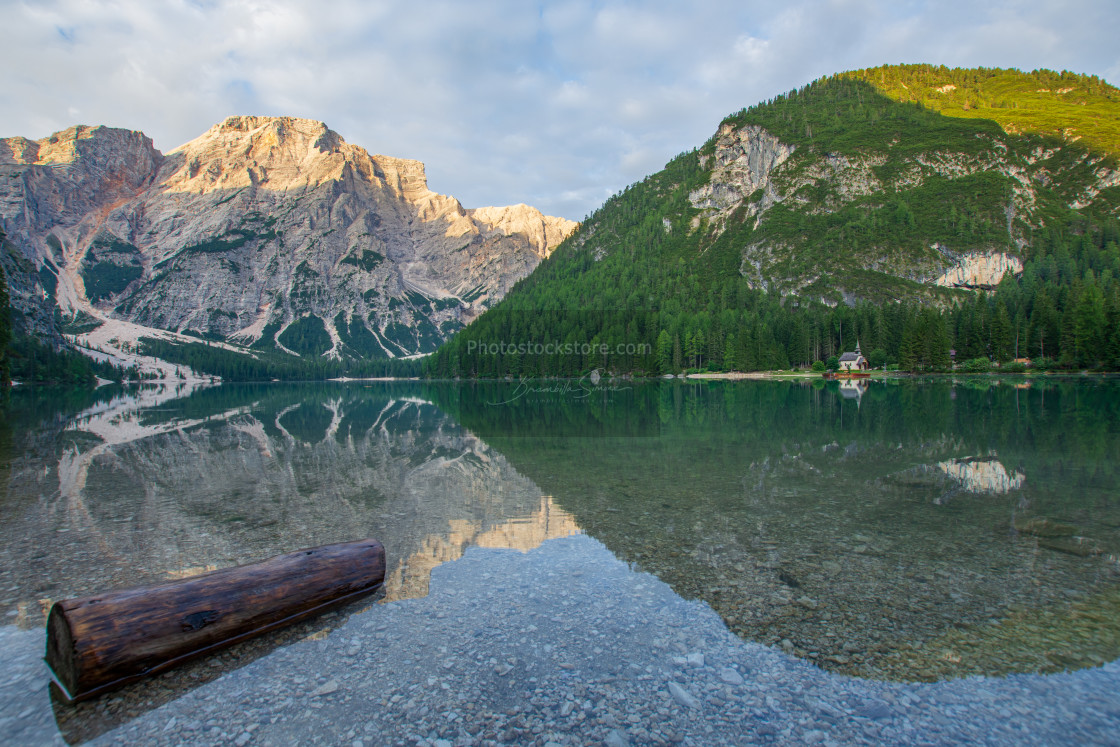 """""""View on Pragser Wildsee with wooden trunk in the water"""" stock image"""