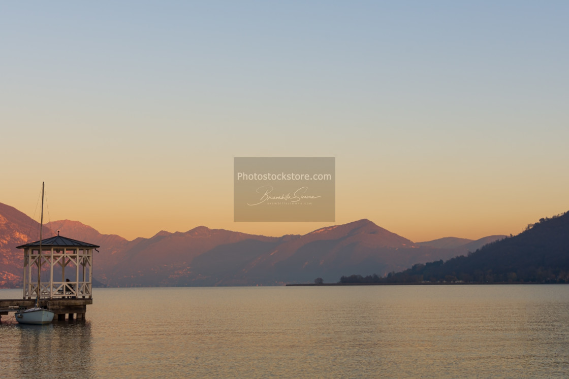 """""""sunset over the quiet waters of Lake Iseo"""" stock image"""