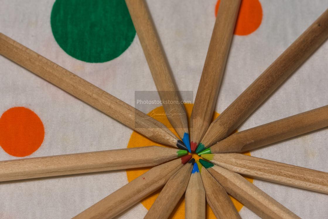 """Colored pencils placed like rays. like a sun"" stock image"