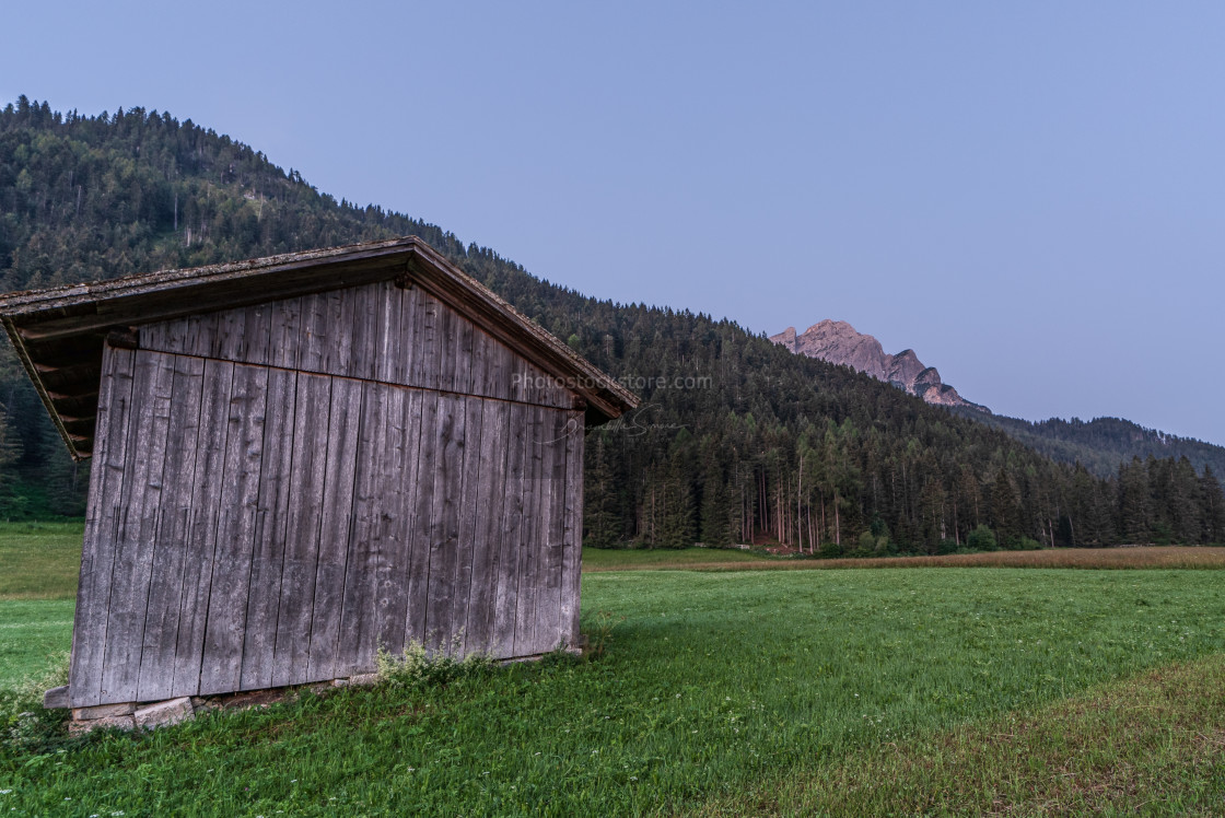 """""""Wooden shed immersed in the mountain landscape"""" stock image"""