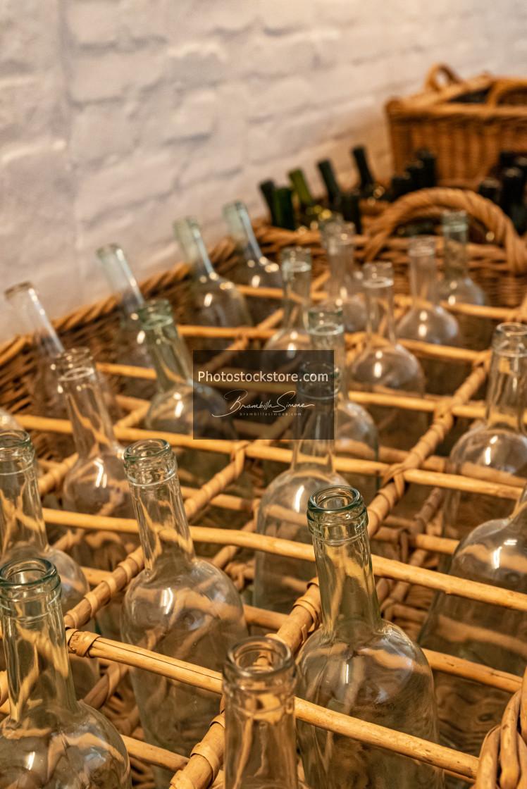 """Empty clear glass bottles ready for bottling wine"" stock image"