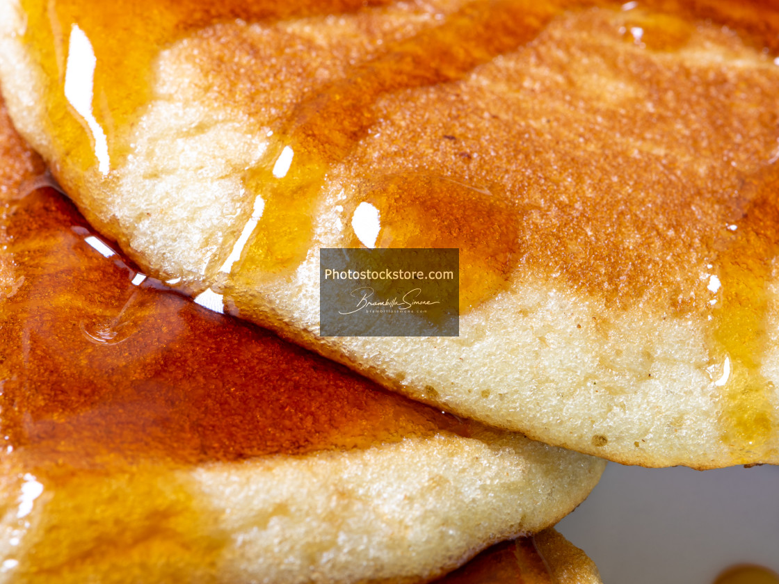 """""""Detail of homemade pancakes wet with maple syrup"""" stock image"""
