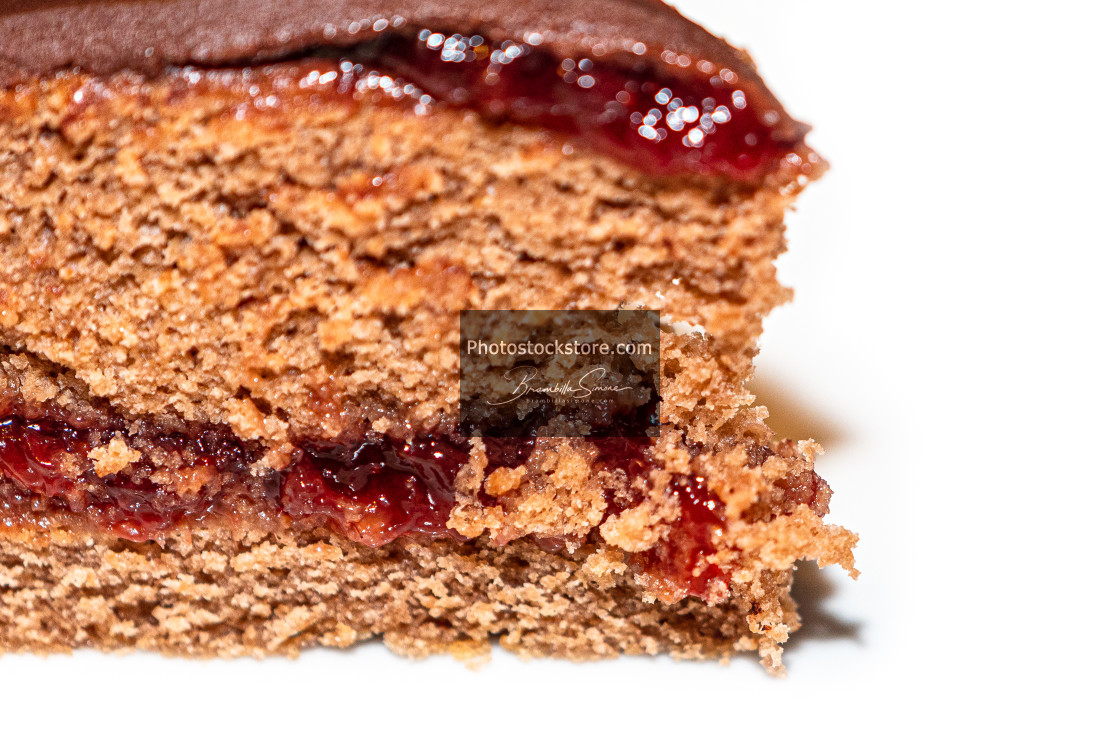 """Detail of slice of chocolate cake with strawberry jam filling"" stock image"