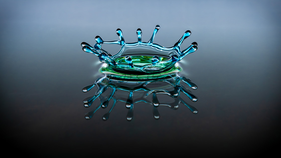 """One drop but many reflections"" stock image"