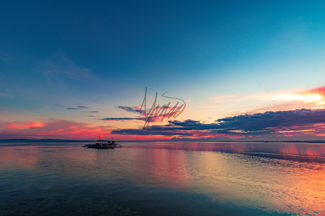 """""""Clouds On Fire As The Sun Sets Over Pacific Resort - Cebu, Philippines, Asia"""" stock image"""