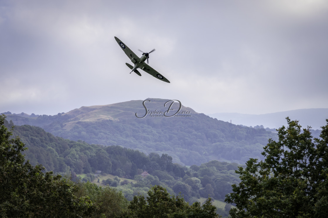 """""""Spitfire over the Malvern Hills"""" stock image"""