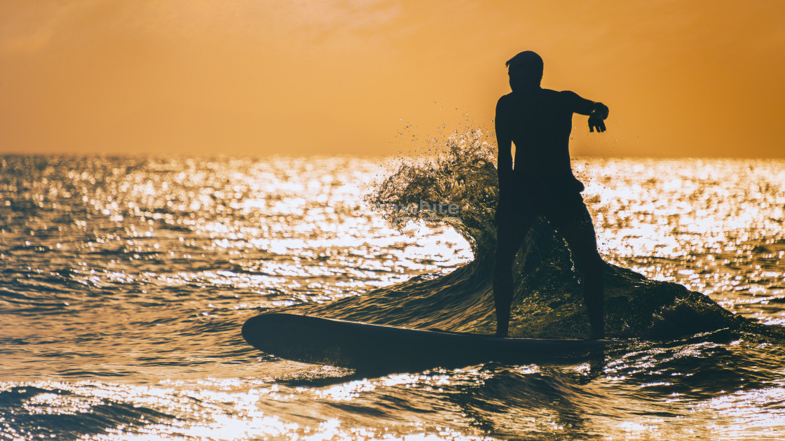 """""""Surfing sunset silhouette"""" stock image"""