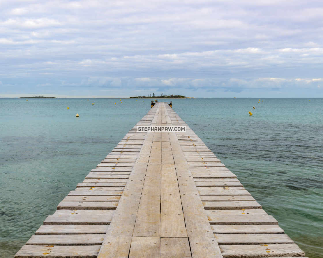 """Wooden pier into Anse Vata // Noumea, New Caledonia"" stock image"