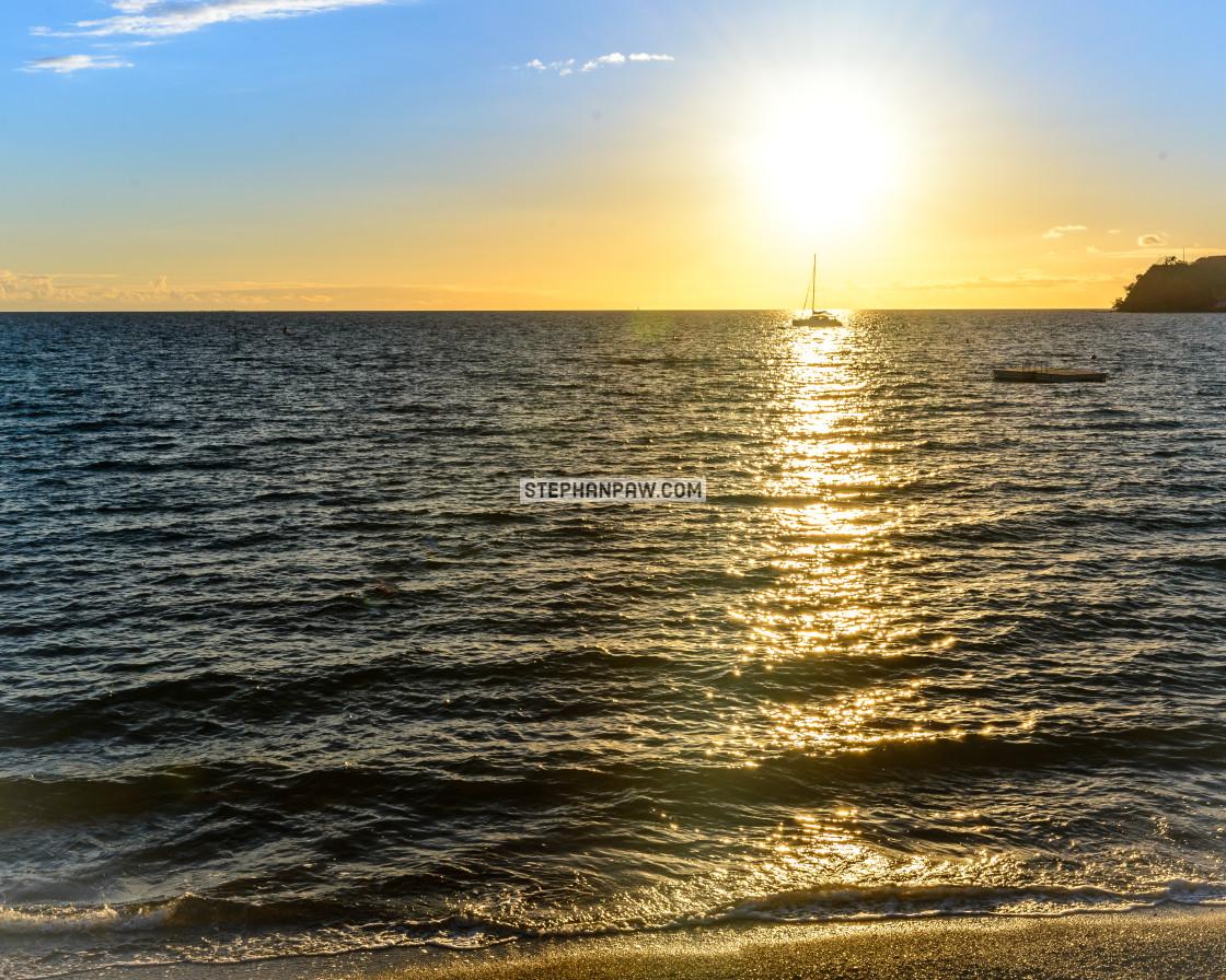 """Sailing boat throught the sunset // Noumea, New Caledonia"" stock image"