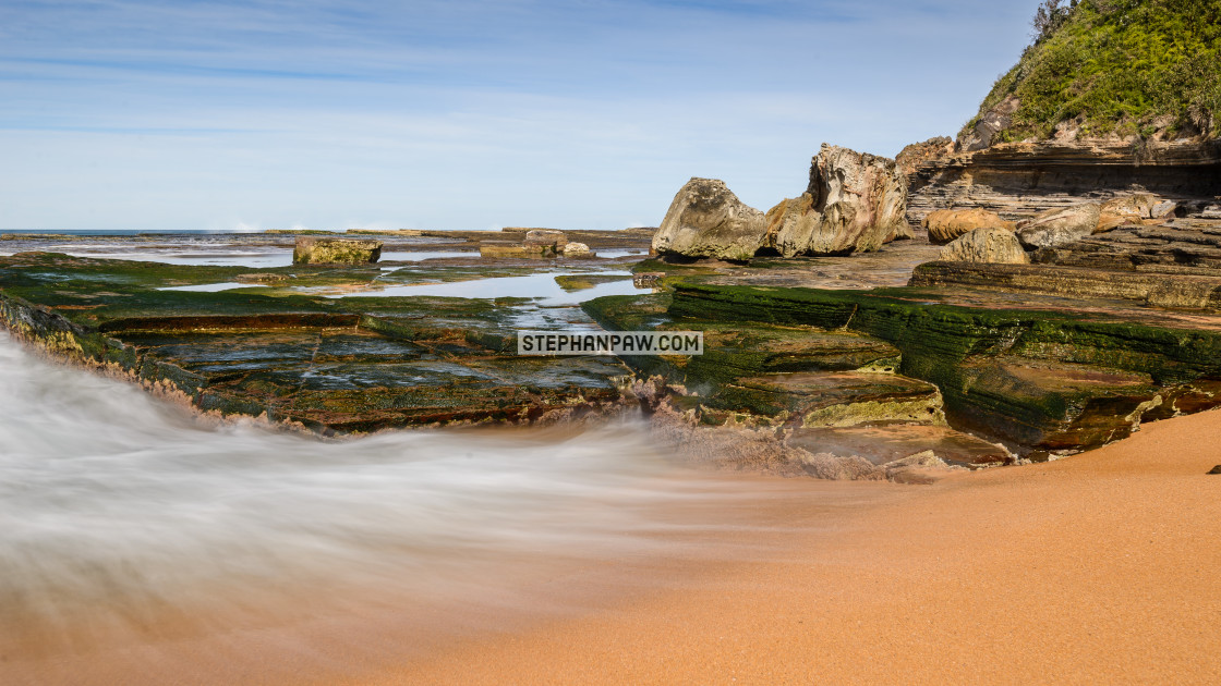 """Swirling surf of Turimetta Beach // Sydney, Australia"" stock image"