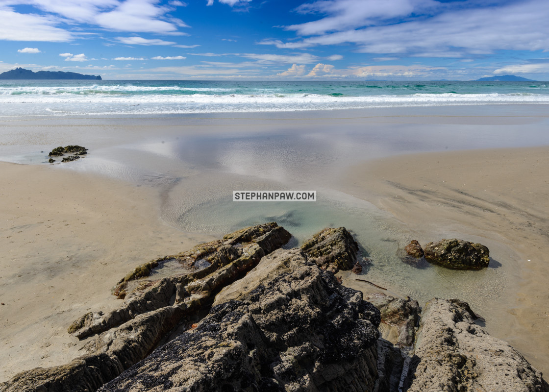 """Sea rocks of Mangawhai Heads // Northland, New Zealand"" stock image"