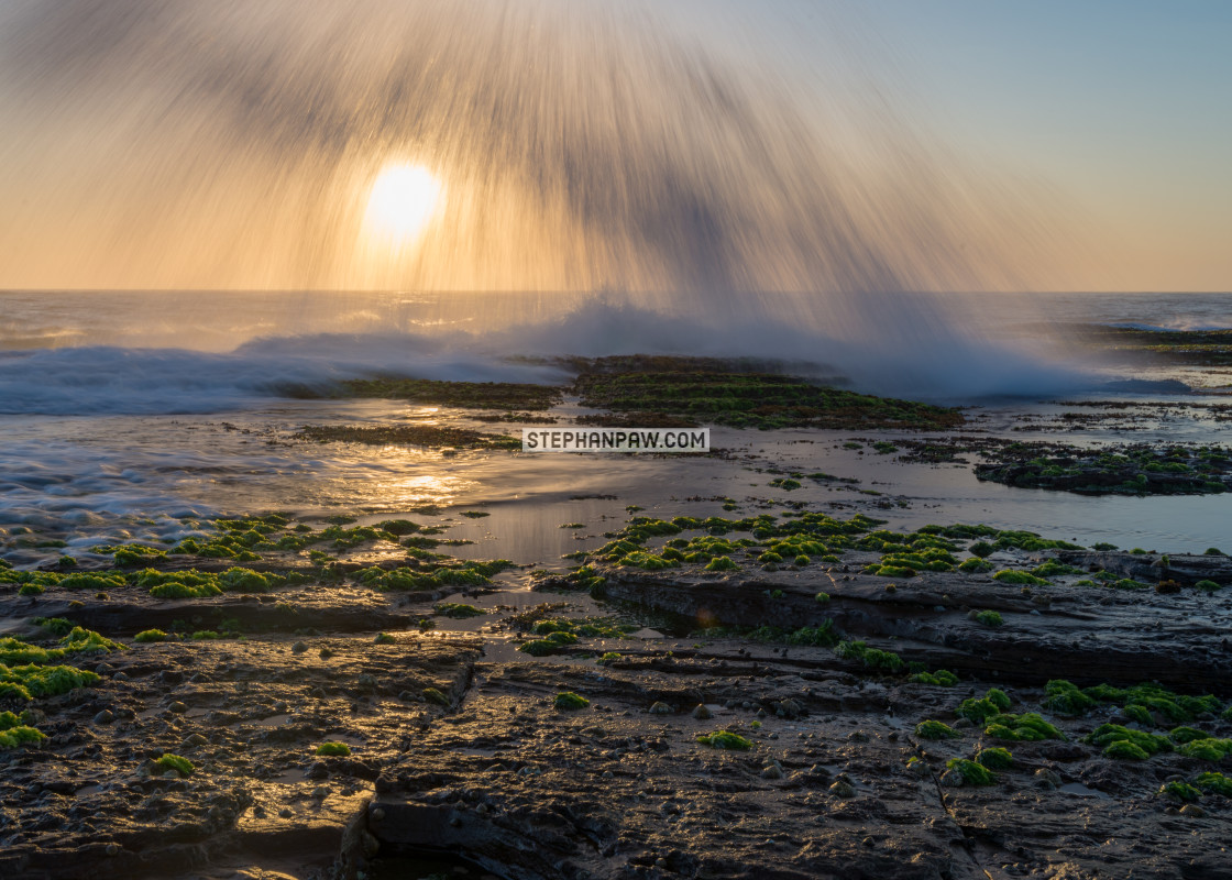 """Sunrays through the waves off Narrabeen // Sydney, Australia"" stock image"