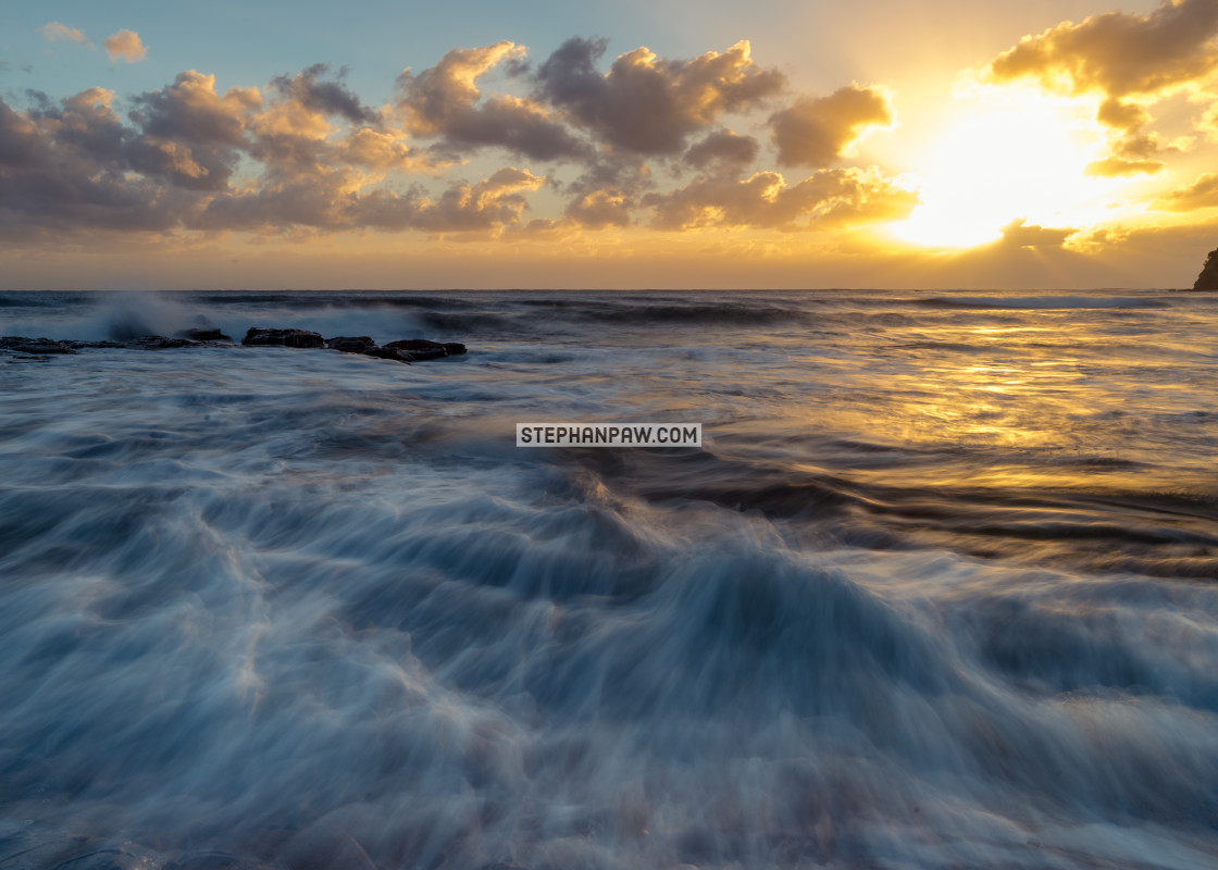 """Golden sunrise off Collaroy Beach // Sydney, Australia"" stock image"