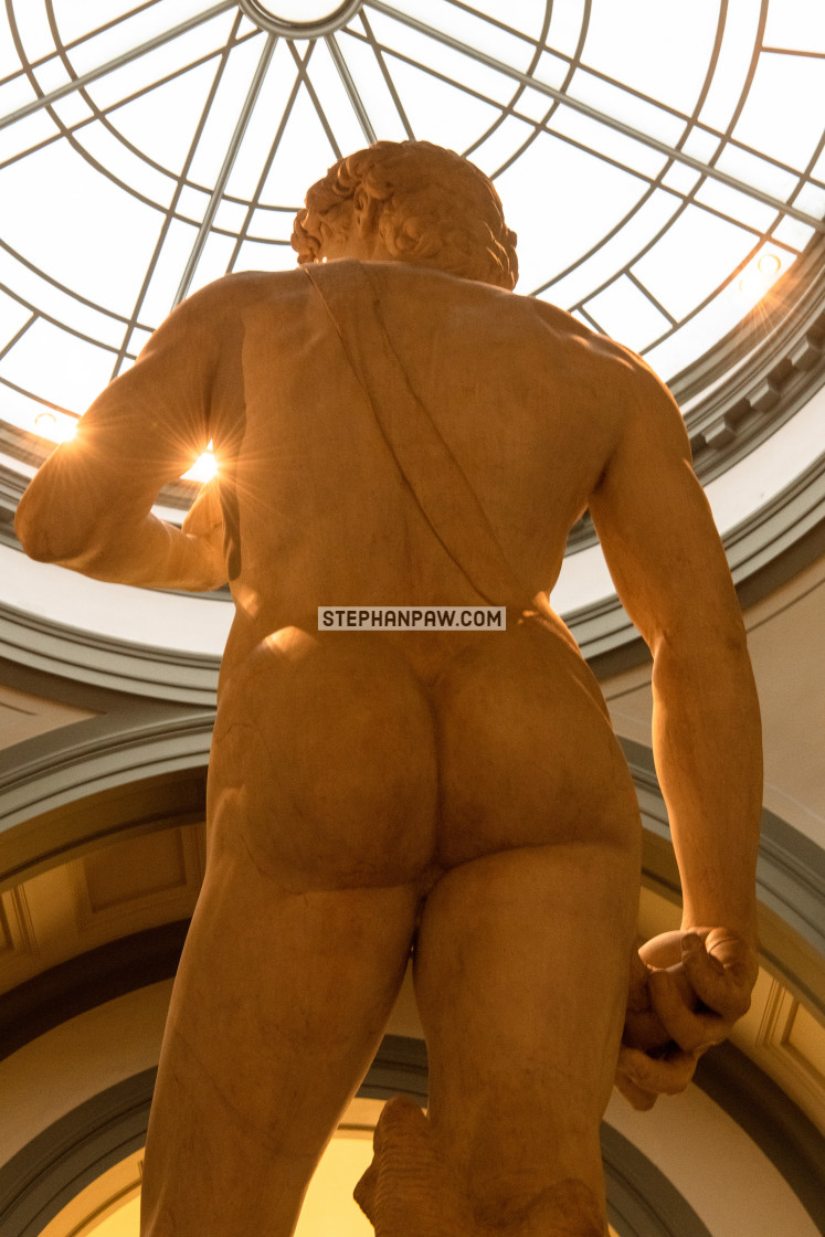 """Sunburst through Michelangelo's David // Florence, Italy"" stock image"