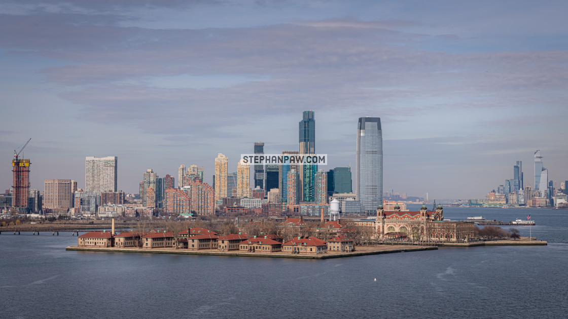 """""""Ellis Island and Jersey City over the Hudson // Liberty Island,"""" stock image"""