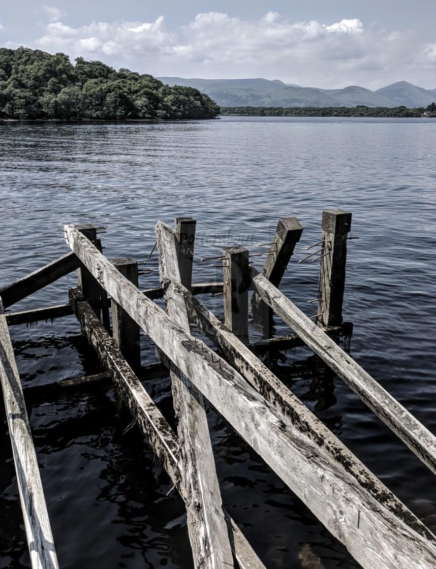 """Old Scottish Pier supports on Loch Lomond"" stock image"