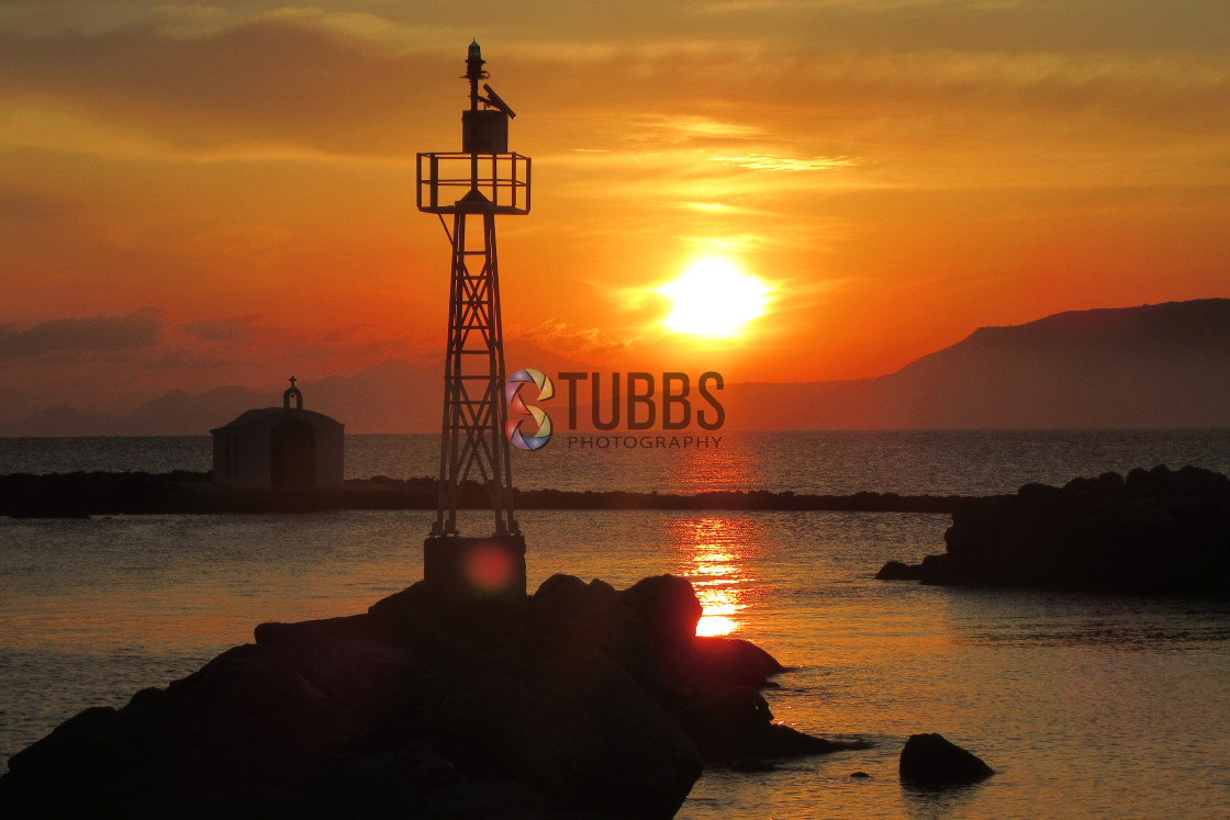 """Sunrise Over Georgiopoulos"" stock image"