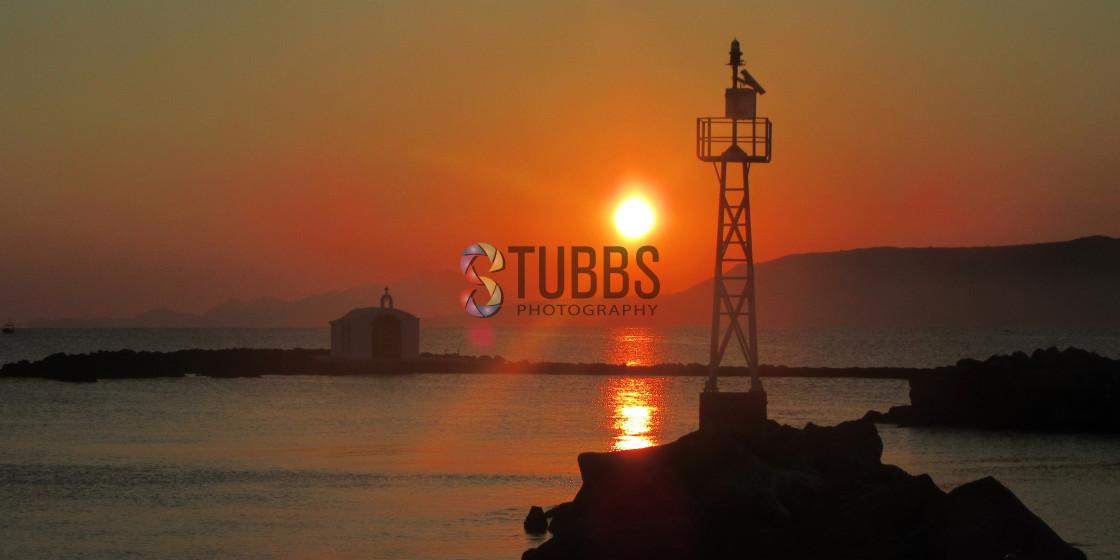 """""""Sunrise over Agios Nikolaos Chapel,"""" stock image"""