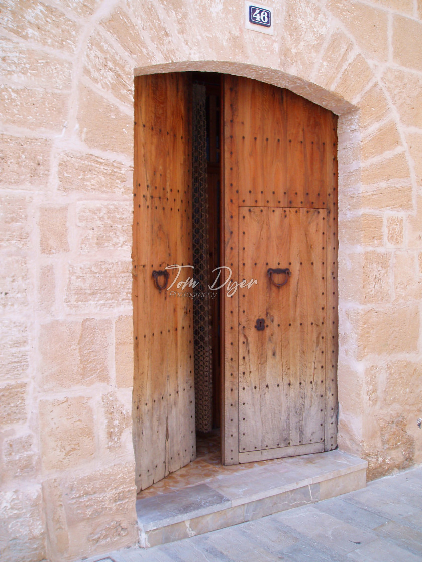 """Rustic Doorway in Alcudia, Mallorca"" stock image"