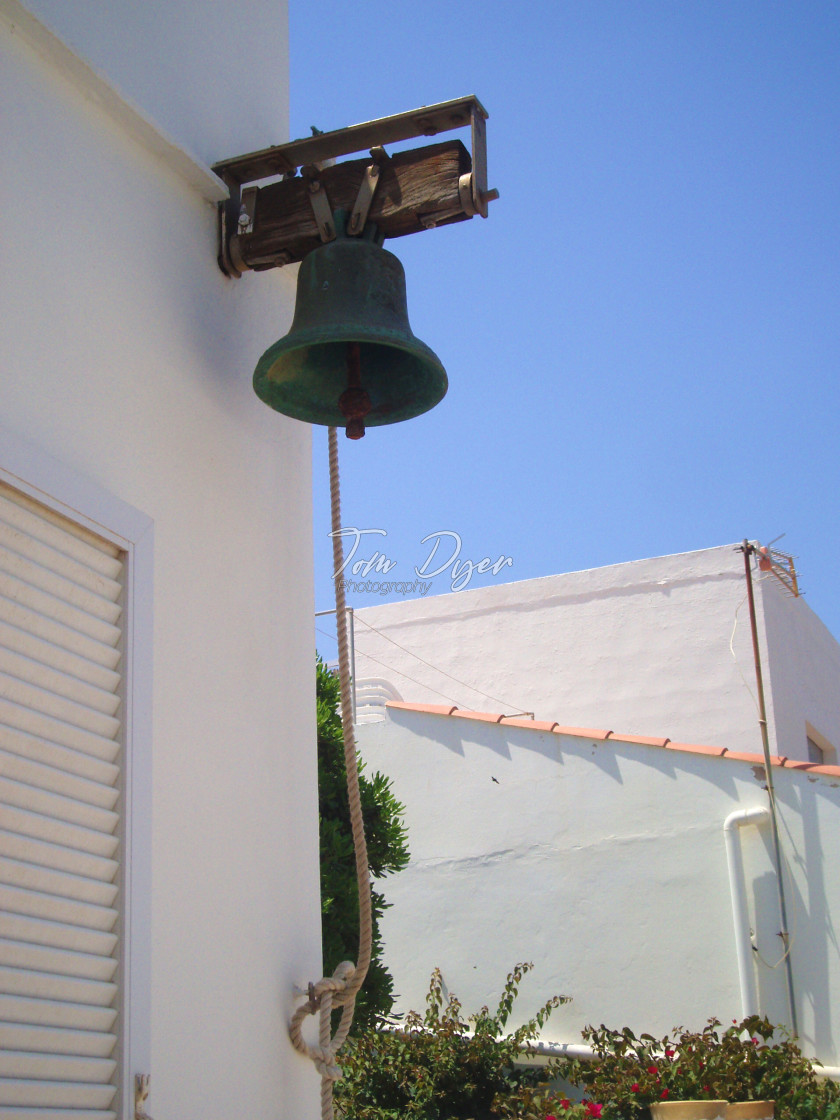 """Old Bell on a Wall, Menorca, Spain"" stock image"